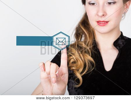 technology, internet and networking concept. beautiful woman in a black business shirt. woman presses mail button on virtual screens, empty field for notes .