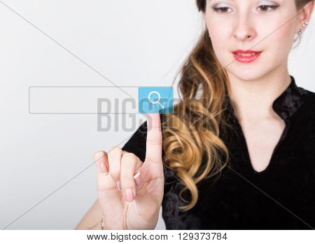 technology, internet and networking concept. beautiful woman in a black business shirt. woman presses search button on virtual screens, empty field for notes.