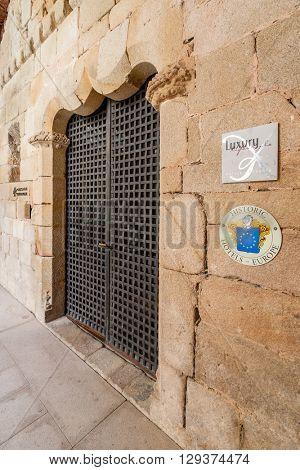 Crato, Portugal. April 4, 2015: Entrance of the Pousadas de Portugal Historical Hotel in the medieval Flor da Rosa Monastery. Belongs to the Historical Hotels of Europe organization.
