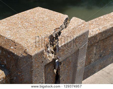 Bridge concrete damage over Trinity River tributary.