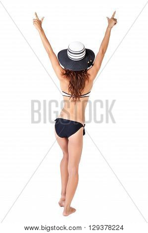 Back of happy and relaxing woman in bikini with hat in white isolated background