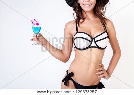 Smiling Woman In Bikini Holding Summer Beverage In White Isolated Background