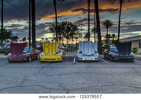 SCOTTSDALE AZ - SEPTEMBER 5: Four classic Chevrolet Corvettes photographed against the sunset on September 5 2015 in Scottsdale Arizona