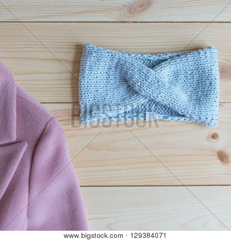 stylish knitted bandage on a wooden table