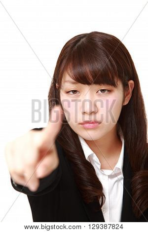 portrait of young Japanese businesswoman scolding on white background