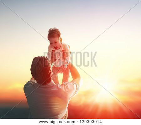 Happy loving family. Father and his daughter baby girl playing and hugging outdoors. Concept of Father's day.