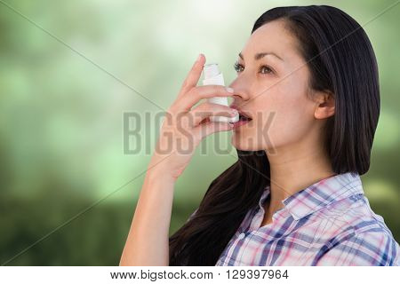Portrait of an asthmatic woman against field against glowing lights