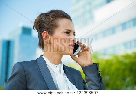 Confident Business Woman In Office District Talking Smartphone