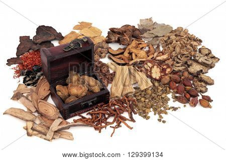 Chinese herb ingredients used in traditional herbal medicine with an old box over white background.
