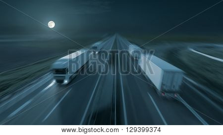 New temperature controlled trucks driving fast towards the moon at night. Speed blurred motion drive on the freeway. Freight scene on the motorway as speed concept.