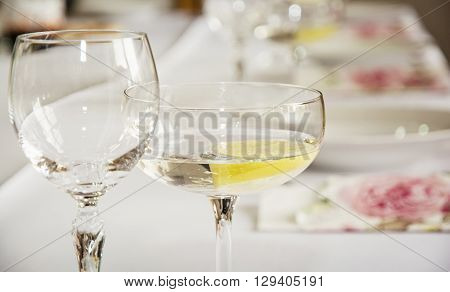 Glasses of vermouth with lemon for birthday party. Refreshments theme. Alcoholic drink.