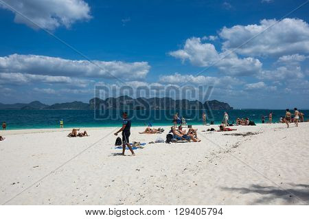 CRABI PROVINCE THAILAND - FEBRUARY 02 2015: Tourists relaxing on the beach of Andaman sea at Krabi province Thailand