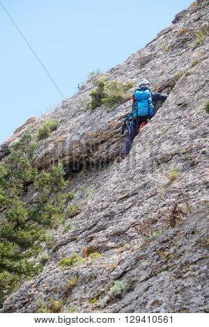 Sudak, the Crimea - April, 2016: the rock-climber climbs a rock slope in Sudak, the Crimea
