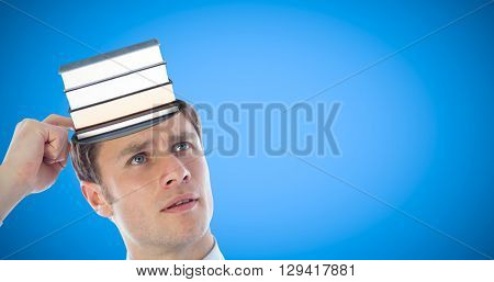 Thinking businessman scratching head against blue background