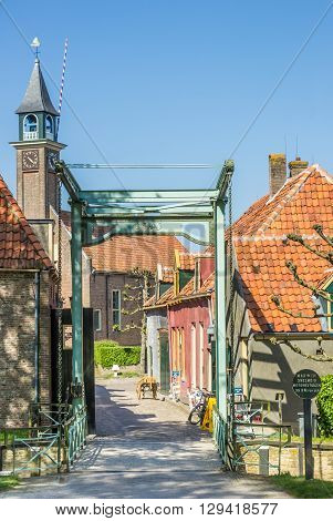 ENKHUIZEN, NETHERLANDS - MAY 9, 2016: Bridge and little houses in Enkhuizen, Netherlands
