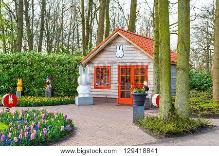 Lisse, Netherlands - April 4, 2016: Colorful Pavillion and flower blossom in dutch park spring garden Keukenhof, Lisse, Netherlands