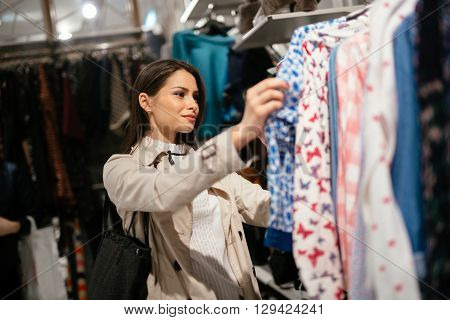 Beautiful young cute businesswoman buying modern clothes