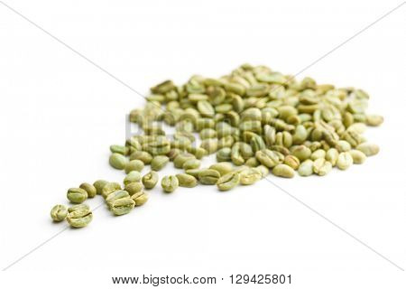 The green coffee beans. Unroasted coffee beans isolated on white background.