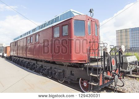 Saint-Petersburg, Russia - May 11, 2016: The railway car in red, which stands on the platform. The first Soviet locomotive experienced Haeckel.