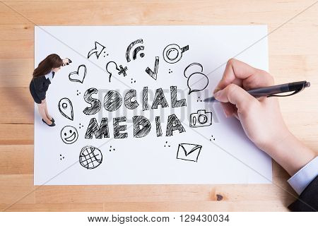 Social Media Concept - business woman look paper and see social media text and icon on the paper great for your design asian