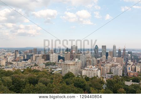 Photo shows landscape view of Montreal city during autumn sunny day.