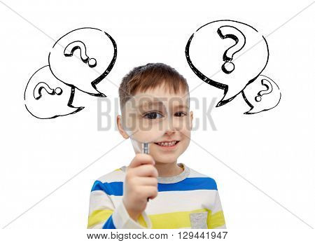 childhood, investigation, discovery, search and people concept - happy little boy looking through magnifying glass with question marks