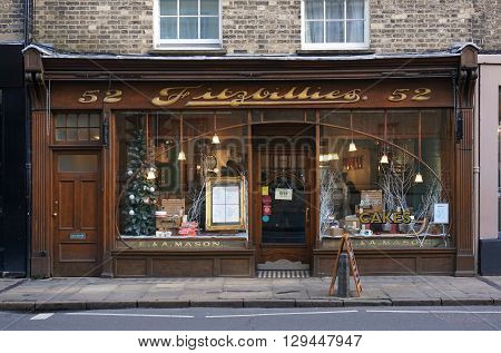 CAMBRIDGE, UK - DECEMBER 23: People sit inside the well-known Fitzbillies, a traditional bakery and cafe on Trumpington Street in Cambridge, England on December 23, 2015.