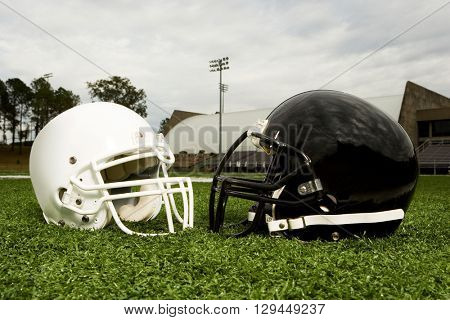 Black and white football helmets