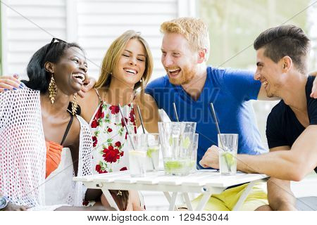 Friends laughing and hugging each outher outdoors and being happy