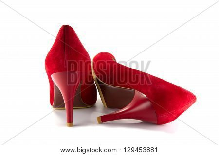 a pair of red shoes standing isolated on white background