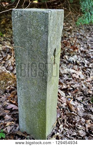 Aged stony milestone with a number one (1) craved into the stone as a symbol of start/beginning