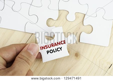White Puzzle With Word Insurance And Policy.