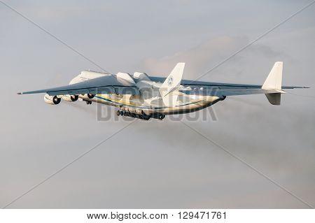 PRAGUE CZE - MAY 12: Antonov 225 Mriya airplane departs from Airport Vaclava Havla in Prague May 12 2016 PRAGUE CZECH REPUBLIC. The biggest airplane in the world.