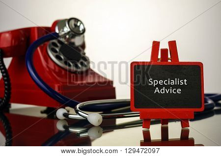 Medical Concept.phone And Stethoscope On The Table With Specialist Advice Words On The Board.