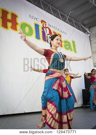 NEW YORK - APR 30 2016: A female dancer from NYC Bhangra uses the tripataka mudra, a hand gesture, while performing on stage at the Holi Hai Festival of Colors in New York on April 30 2016.