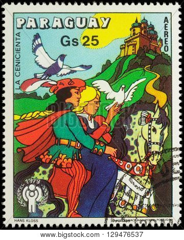 MOSCOW RUSSIA - MAY 11 2016: A stamp printed in Paraguay shows Cinderella and Prince - scene from a fairy tale series