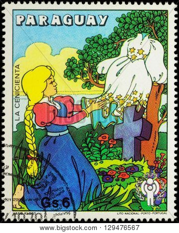 MOSCOW RUSSIA - MAY 11 2016: A stamp printed in Paraguay shows Cinderella with new dress scene from fairy tale series