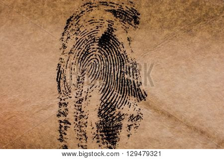 Fingerprint on a brown  old styled paper