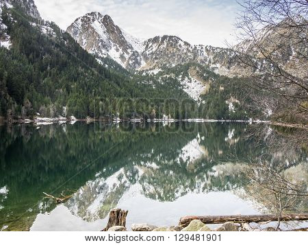 The reflections of the mountains on the waters of the lake