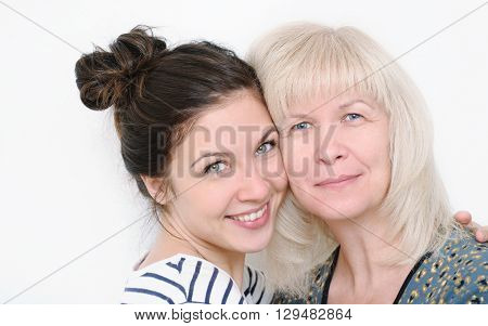 happy family portrait of embracing smiling mother and daughter on white background happy family concept; happy generation lifestyle concept