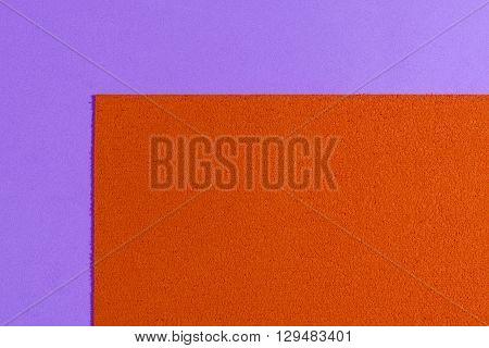 Eva foam ethylene vinyl acetate sponge plush orange surface on light purple smooth background