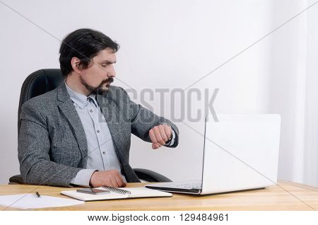 Portrait Of Attractive Serious Businessman Working At His Desk