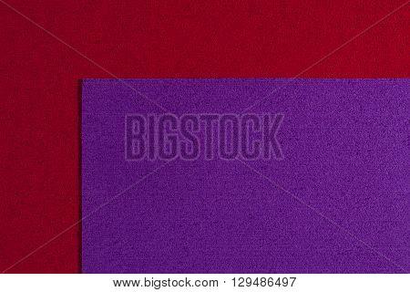 Eva foam ethylene vinyl acetate purple surface on red sponge plush background