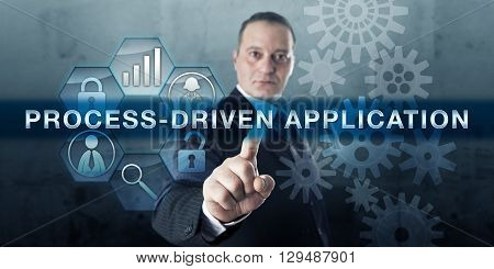 Developer pushing PROCESS-DRIVEN APPLICATION on a touch screen display. Process management metaphor and business concept for enterprise solution software application relating to humans and systems.