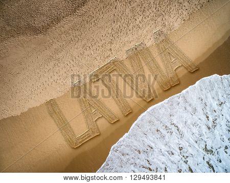 Latvia written on the beach