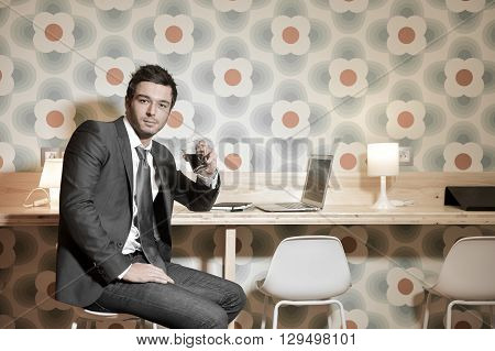 Handsome Business Man In Restaurant Talking On The Phone