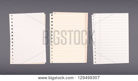 Stacked white, brown squared, ruled notebook paper are on dark background.