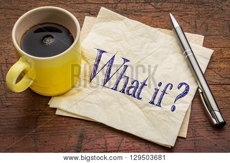 What if question - handwriting on napkin with a yellow cup of espresso coffee against rustic wood