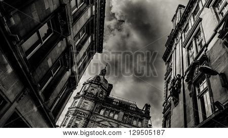 Buchanan Street Architecture In Glasgow Scotland Under Rainy Sky