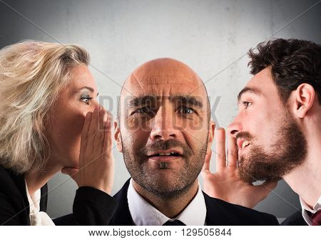 Man and woman talking to man ear